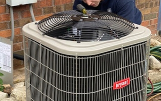 JM Heating team installing a new air conditioner