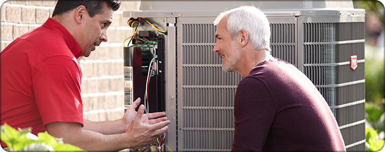 hvac service tech discussing hvac options with homeowner