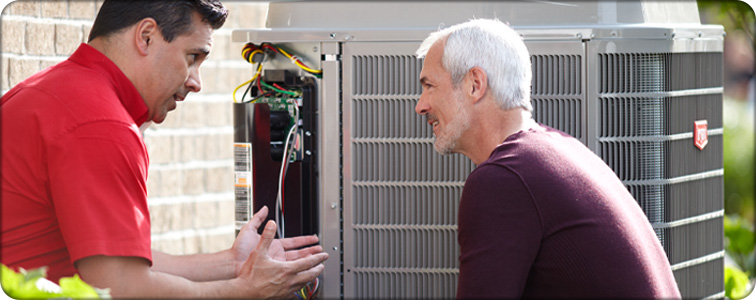 Air Conditioner repair technician discussing the homeowner's AC questions