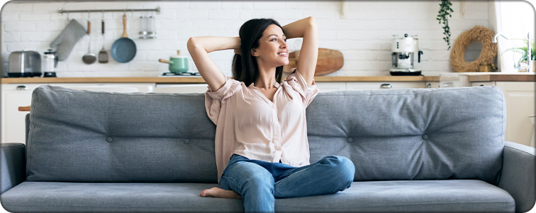 woman enjoying the clean air in her home