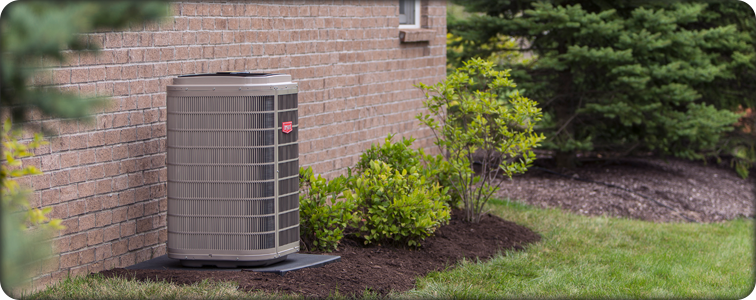 Bryant air conditioner outside of brick home.
